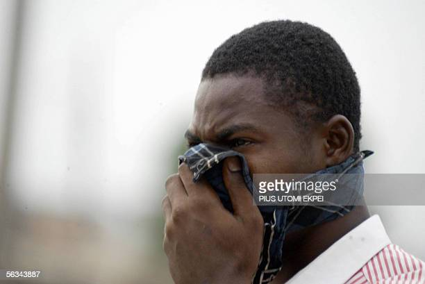 Man covers his nose with handkerchief as police shoot canisters of teargas to disperse members of the banned Movement for the Actualisation of the...