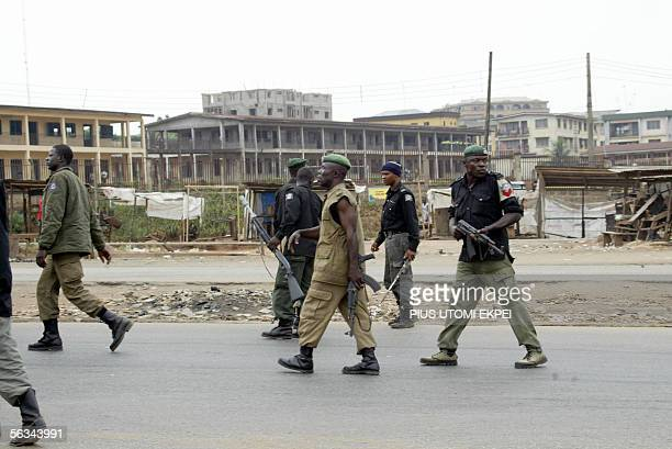 Antiriot police officers patrol a road to disperse members of the banned Movement for the Actualisation of the Sovereign State of Biafra in Onitsha...