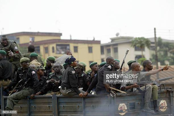 Anti-riot police officers patrol a road to disperse members of the banned Movement for the Actualisation of the Sovereign State of Biafra in Onitsha...