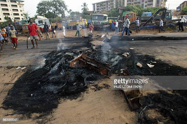 Members of the banned Movement for the Actualisation of a Sovereign State of Biafra stand in front of a bonfire in Onitsha, 05 December 2005....