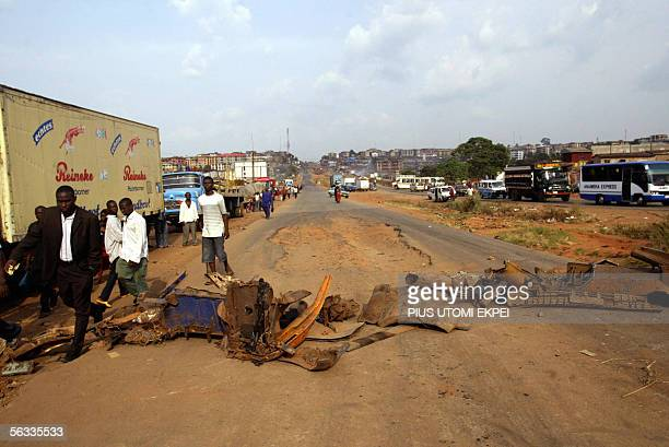 People walk past barricades set by the banned Movement for the Actualisation of a Sovereign State of Biafra in Onitsha, 05 December 2005. Millions of...