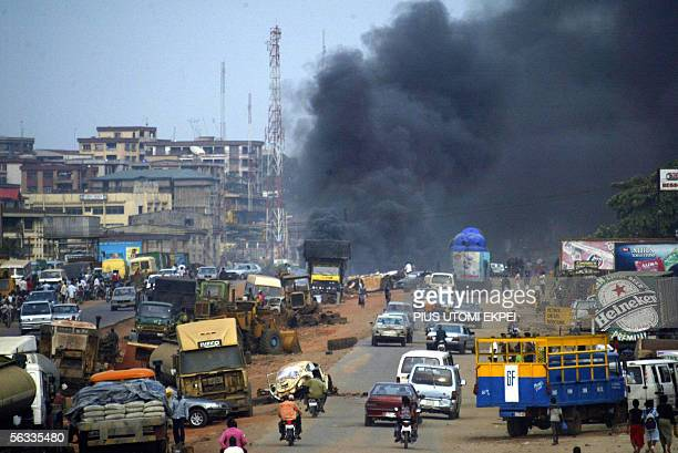 Smoke rise up into the sky from a bonfire set by the banned Movement for the Actualisation of a Sovereign State of Biafra in Onitsha, 05 December...