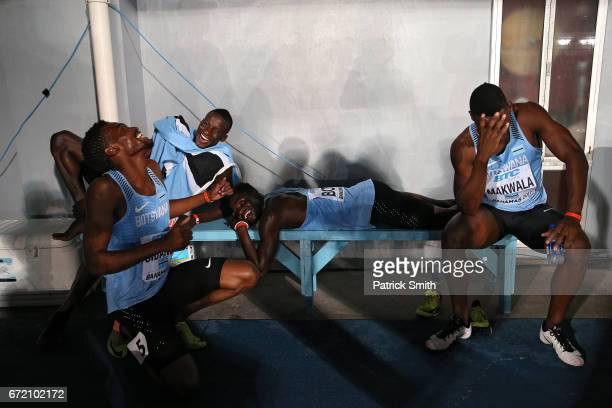 Onkabetse Nkobolo of Botswana shares a laugh with teammates Baboloki Thebe Karabo Sibanda and Isaac Makwala before collecting their second place...