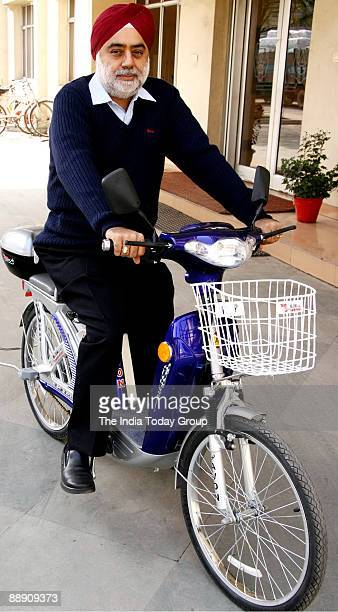 Onkar Singh Pahwa MD Avon Cycles sitting on Ebike cycle in Ludhiana India