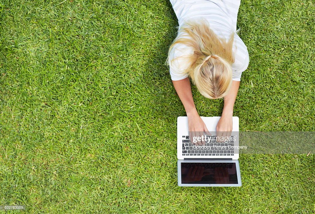 Online at the park : Stock Photo