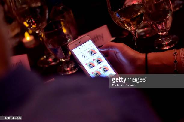 Online bidding on display at the GO Campaign Gala 2019 on November 16 2019 in Los Angeles California