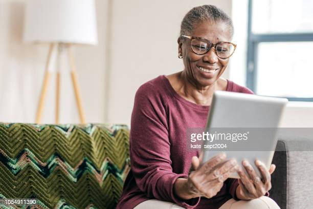 online doctors consultation - black granny stock photos and pictures