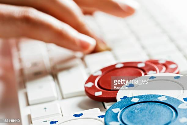 Online gambling: casino chips on computer keyboard