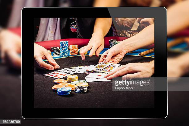 online gambling on tablet - poker card game stock photos and pictures