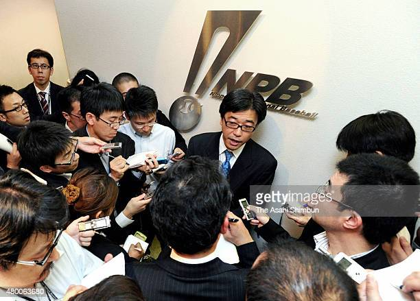 Online game company DeNA Chairman Makoto Haruta is surrounded by media reporters after handing in the application documents to become a member of...