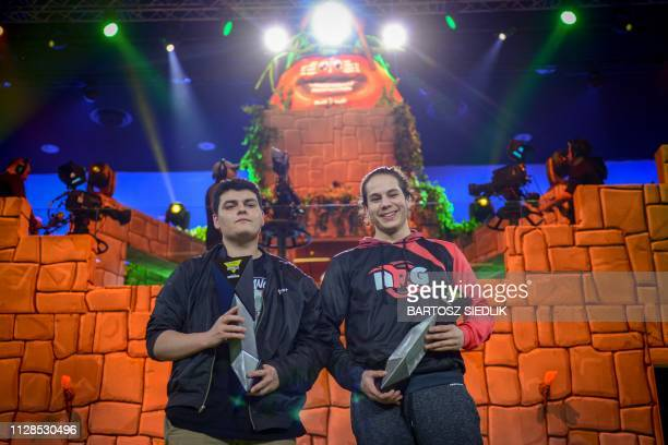 Online gamers Ghost and NRG celebrate after winning the ESL Katowice Royale Featuring Fortnite Tournament during the Intel Extreme Masters Katowice...