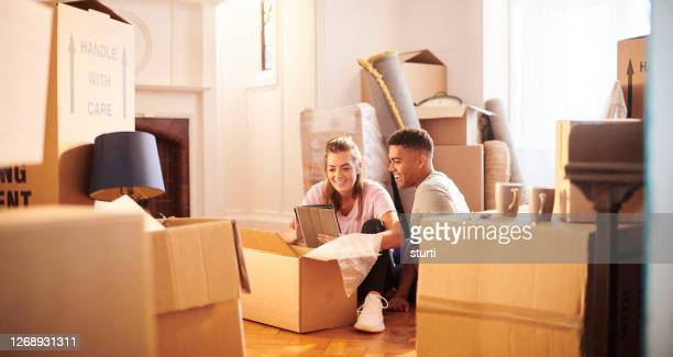 online house insurance - couple stock pictures, royalty-free photos & images