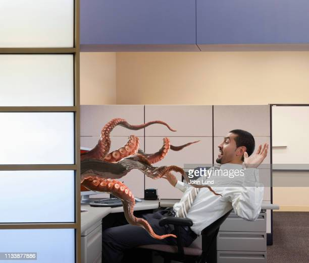 online networking danger seen in tentacles in the office - tentacle stock pictures, royalty-free photos & images