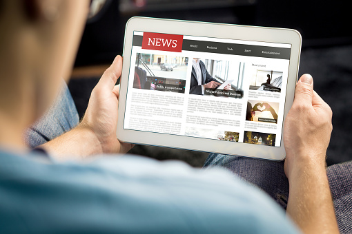 Online news article on tablet screen. Electronic newspaper or magazine. Latest daily press and media. Mockup of digital portal and website. Happy person using web service in the morning. 1158778963