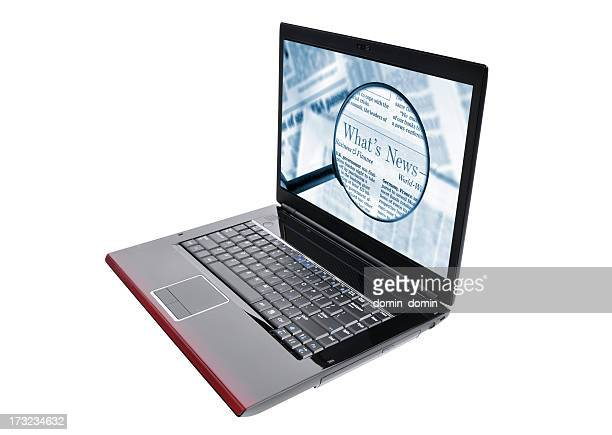 OnLine News, opened laptop with magnifying glass on computer screen