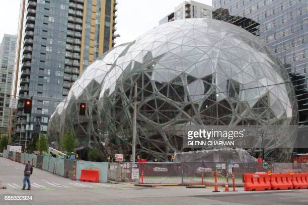 Online retail powerhouse Amazon is constructing an eyecatching Spheres office building to feature waterfalls tropical gardens and other links to...