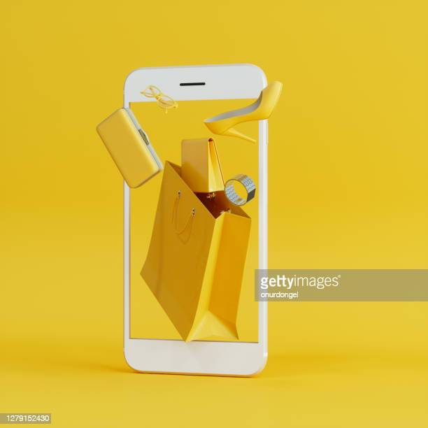 online shopping at smartphone with flying yellow wallet, clutch bag and shoe background - pochette borsetta foto e immagini stock