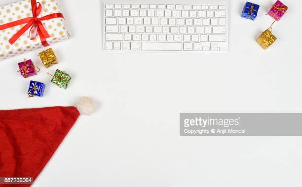 Online shopping Christmas gifts flat lay copy space with computer keyboard