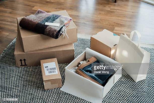 online shopping makes life easier - unboxing online purchase - gift stock pictures, royalty-free photos & images