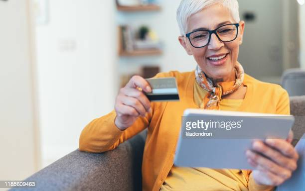 online shopping - stereotypically upper class stock pictures, royalty-free photos & images
