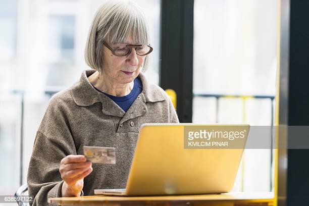 online shopping - seniors - financial technology bildbanksfoton och bilder