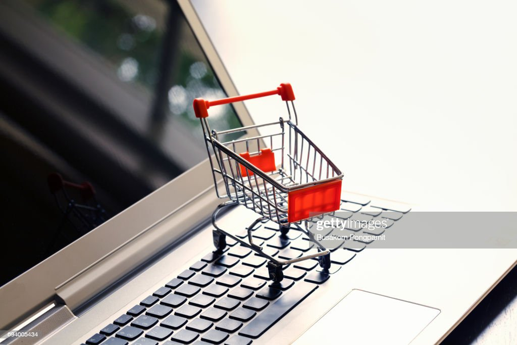 Online shopping with cart idea concept : Stock Photo