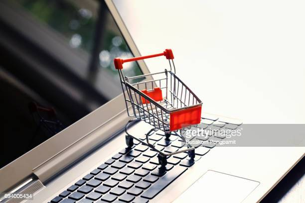 online shopping with cart idea concept - marketing icons stock photos and pictures