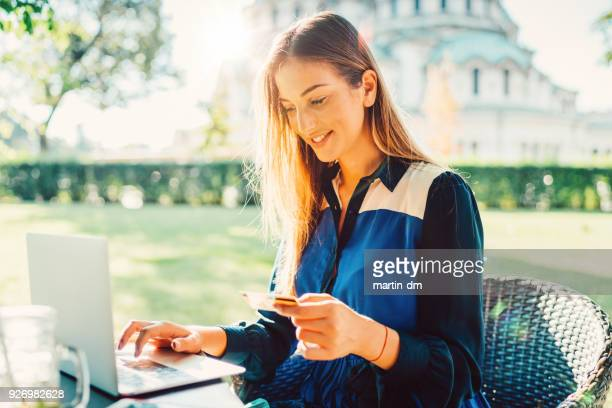 online shopping with credit card - making a reservation stock photos and pictures