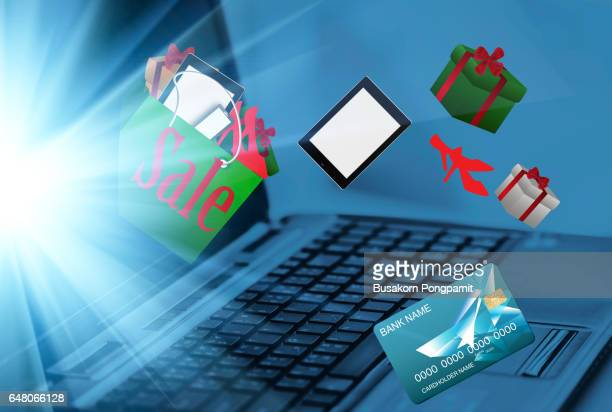 "online shopping.  with laptop and credit card, making online payment, close up ""nonline shopping with digital laptop - gift icon stock photos and pictures"