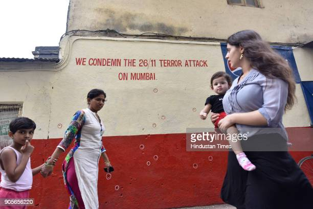 Onlooker passby the bullet marks of 26/11 outside Chabad House on January 15 2018 in Mumbai India 26/11 terrorist attack survivor Moshe Holtzberg...