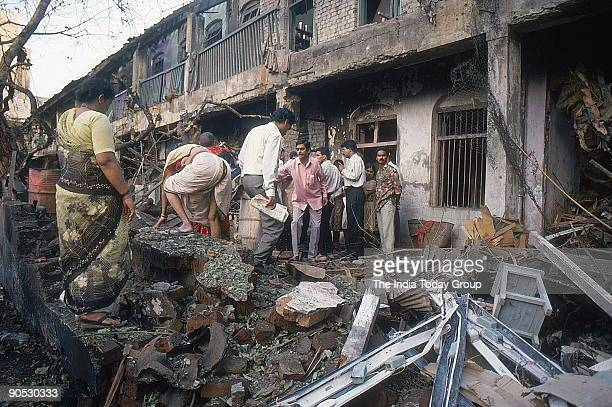 Onlookers at a bomb blast site in Mumbai