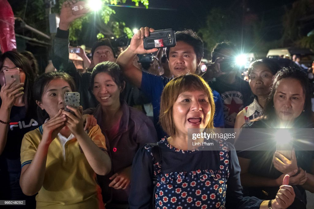 Onlookers at the junction in front of Chiangrai Prachanukroh Hospital watch and cheer as ambulances transport the last rescued schoolboys and their coach from a helipad nearby to Chiangrai Prachanukroh Hospital on July 10, 2018 in Chiang Rai, Thailand. Divers began an effort to pull the 12 boys and their soccer coach on Sunday morning after they were found alive in the cave at northern Thailand. Thai Navy SEALs confirmed on Tuesday that the 12 boys, aged 11 to 16, and their 25-year-old coach have now all been extracted safely after they were found alive in the cave at northern Thailand. The boys of the Wild Boars soccer team and their coach are to spend at least a week in a hospital in Chiang Rai Province due to a risk of rare infections.