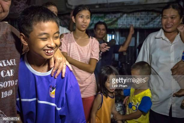 Onlookers at the junction in front of Chiangrai Prachanukroh Hospital watch and cheer as ambulances transport the last rescued schoolboys and their...
