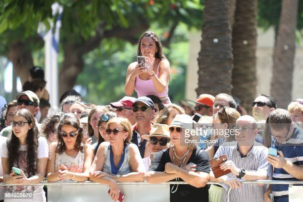 Onlookers await the arrival of Prince William, Duke of Cambridge as he meets singer Netta Barzilai, who won the 2018 Eurovision Song Contest, at the...