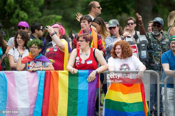 Onlookers cheer as the 2018 Boston Pride Parade passes them on Boylston St on June 9 2018 in Boston Massachusetts