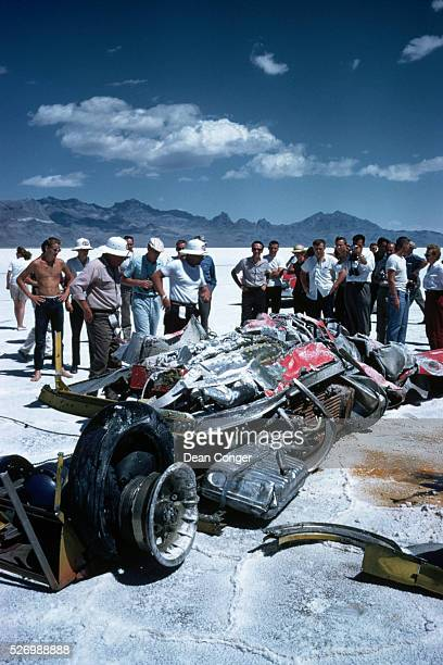 Onlookers examine the wreckage of mechanic Athol Graham's homemade racecar after it went out of control during testing on the Bonneville Salt Flats...
