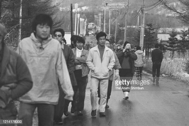 Onlookers gather as the United Red Army members take a hostage at the Asama Sanso lodge on February 27 1972 in Karuizawa Nagano Japan