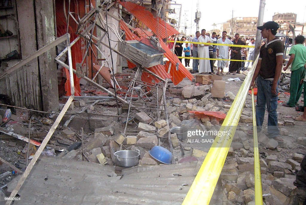 Onlookers gather at the scene of a car bomb explosion at the market of central Baghdad's Rahmaniya district on April 23, 2010. At least 50 people were killed in a series of car bombs near Shiite mosques in Baghdad, an interior ministry official told AFP.