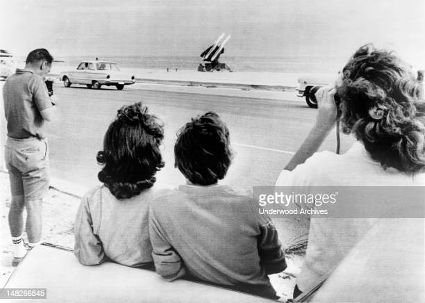 Onlookers gather on George Smathers Beach in Key West, Florida to see the Army's Hawk anti-aircraft missiles positioned there during Cuban Missile...