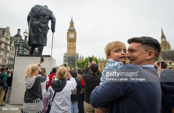Onlookers gather outside the Palace of Westminster in central London as Big Ben's bongs ring out for the last time before renovation work begins