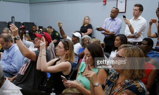 Onlookers record on their phones during a canvassing board meeting at the Broward County Supervisor of Elections Office on November 10, 2018 in...