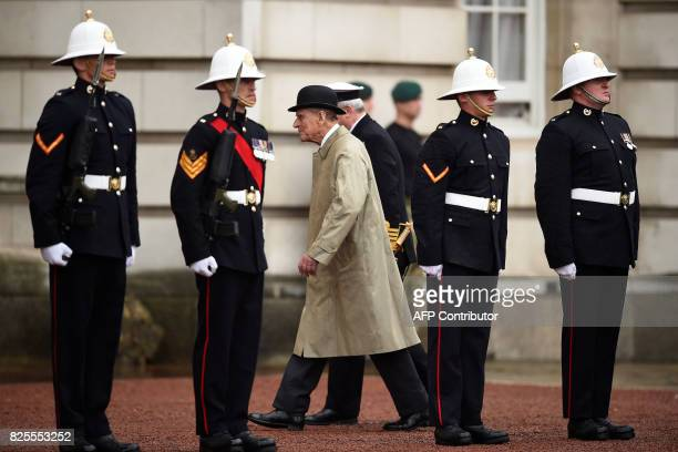 Onlookers watch as Britain's Prince Philip, Duke of Edinburgh, in his role as Captain General, Royal Marines, attends a Parade to mark the finale of...