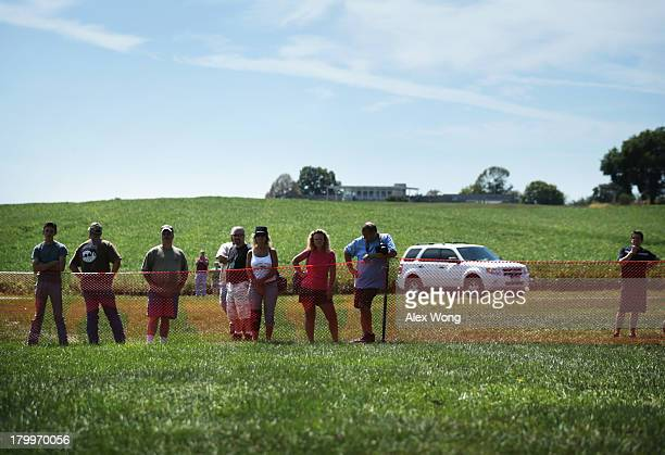 Onlookers watch as members of the Confederate White Knights hold a rally at the Antietam National Battlefield September 7 2013 near Sharpsburg...