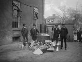 Onlookers watch as suited men stand in front of a large copper kettle picture id90002554?s=170x170