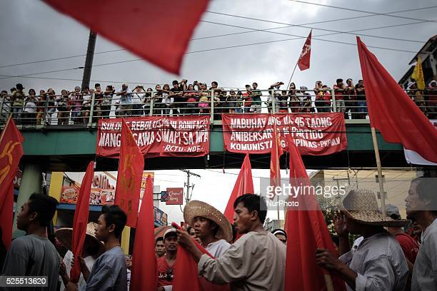 Onlookers watch from a footbridge as protesters hold a demonstration outside the presidential palace in Manila Philippines November 30 2013...