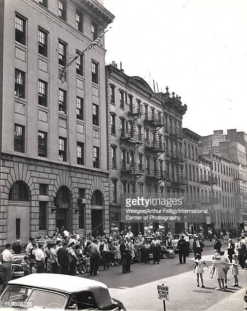 Onlookers watch outside the 10th Precinct police station during the filming the movie 'The Naked City' New York New York mid to late 1940s The film...