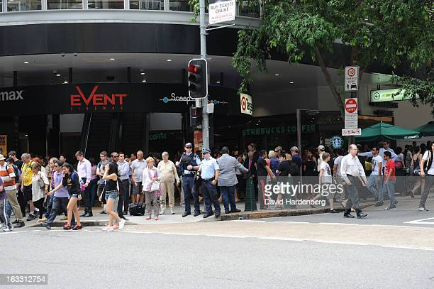 Onlookers watch police in Queen Street Mall after a gunman was subdued by Police and taken to hopsital on March 8 2013 in Brisbane Australia...