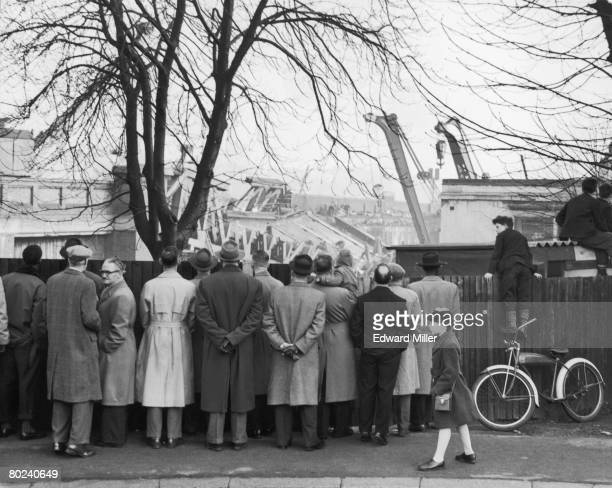 Onlookers watch the progress of repair work near St John's Station at the site of the Lewisham rail crash 8th December 1957 Ninety people were killed...