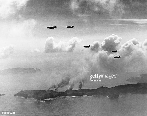 Only 600 Miles from Tokyo Bonin Islands With smoke rising from the ruins of four ships at Haha Jima below them five helldivers of a pacific fleet...