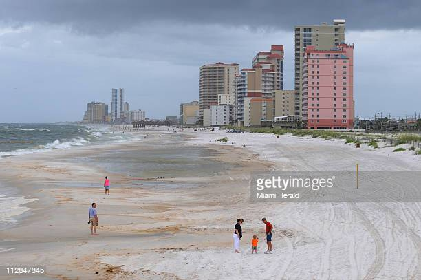 Only a few tourists and locals visit the beaches of Gulf Shores Alabama on Tuesday June 29 2010